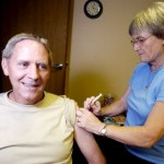 Gary Dickinson gets a hepatitis B booster shot from Eilish McCafferty at Passport Health in Boulder. Dickinson is getting his vaccinations updated before leaving for Uganda and Rwanda with Olive Branch Ministries.