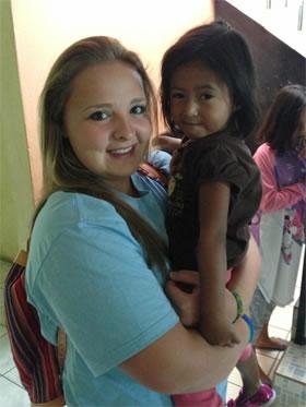 Passport Health Featured Traveler: Mikayla with local children