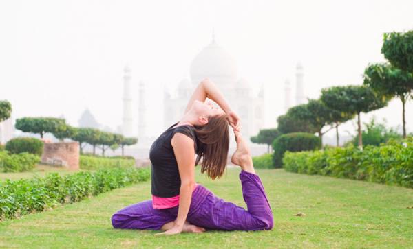 Yoga Asanas in front of Taj Mahal