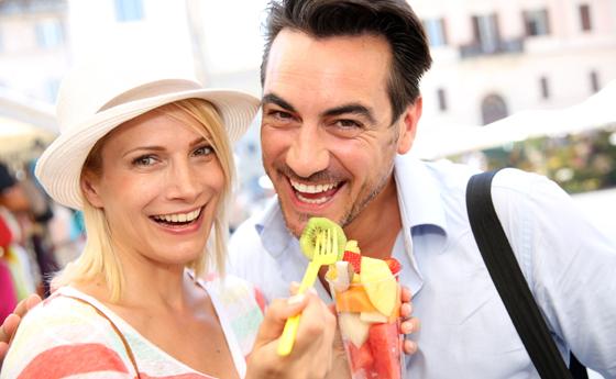 Travelers eating fruit