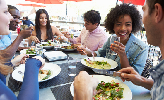 Group of people eating at an outdoor restaurant