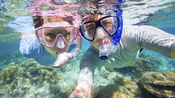 Two Travelers Snorkeling Underwater