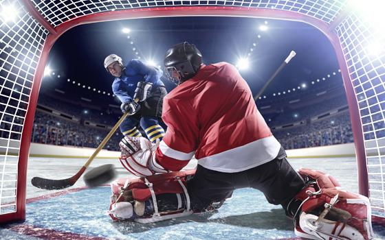 Hockey Player making a goal