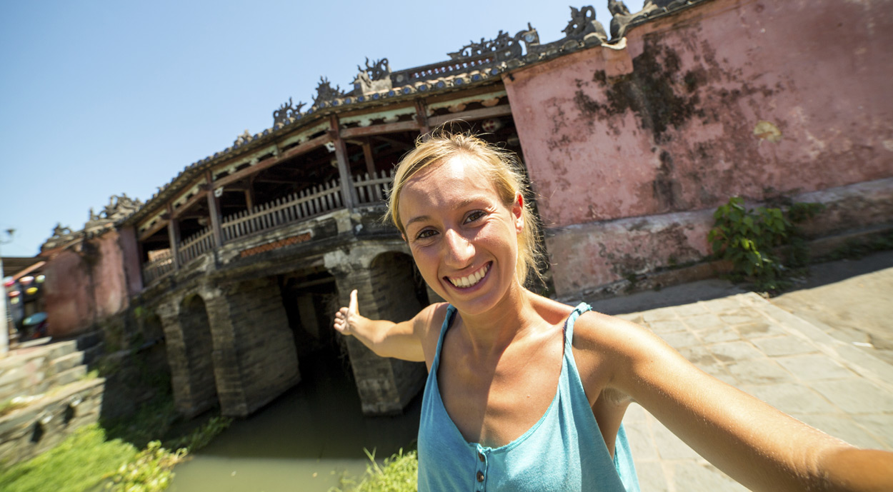 traveler taking photo in Hoi An, Vietnam