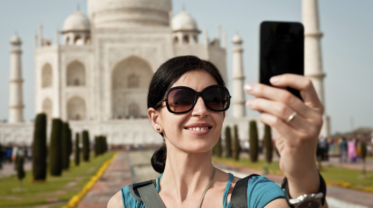 traveler taking photo in India