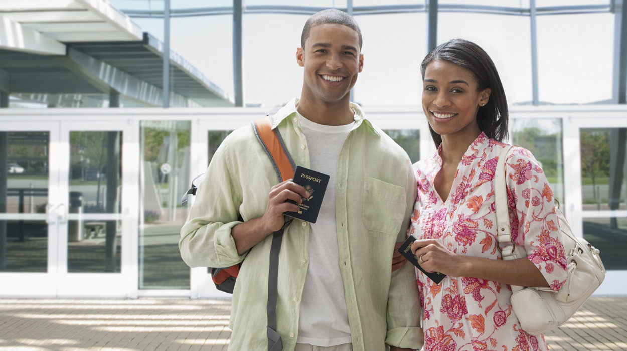 Couple of Travelers holding passports