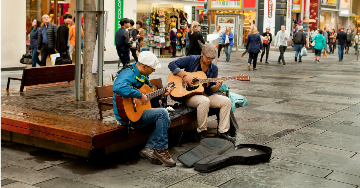 Street performing is one of many ways to earn money while abroad.