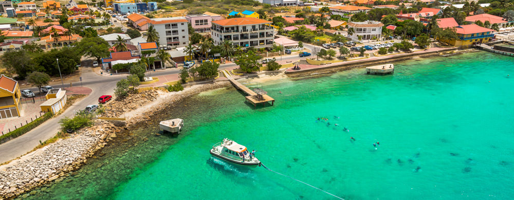 Crystal clear water and fantastic food bring people to Bonaire. Let Passport Health help you stay healthy while you're there with travel advice and more.