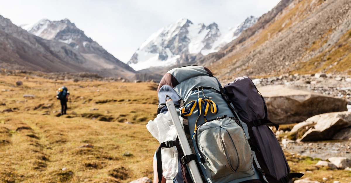Hikers make their way through the mountains of Tien Shan.