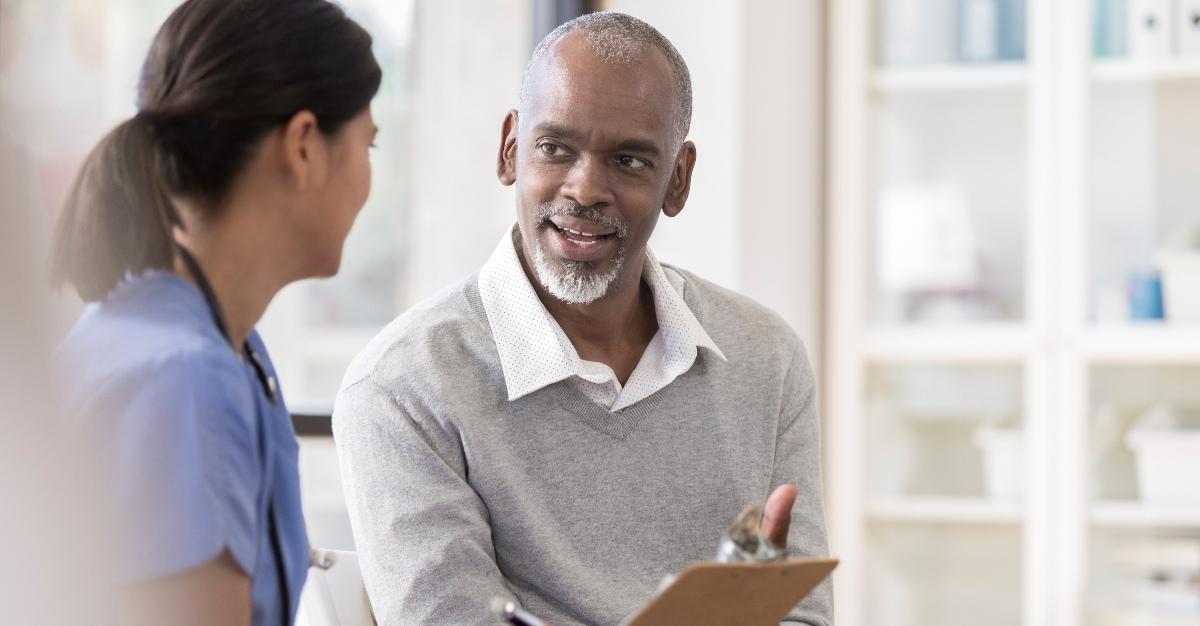 Man speaks to travel health nurse.