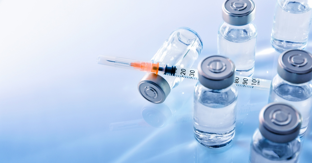Travel health vaccines on a table.