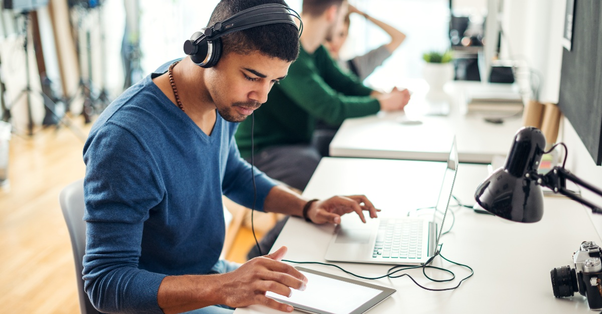 For many employees, music may actually improve their work.