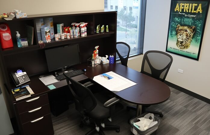 Passport Health Aurora's consultation room is a comfortable space to meet with travel health specialists and receive travel vaccines.