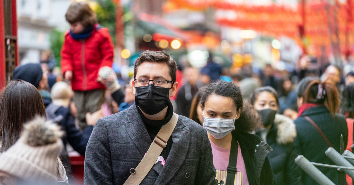 Travelers and locals alike take measures to prevent viruses during a pandemic.