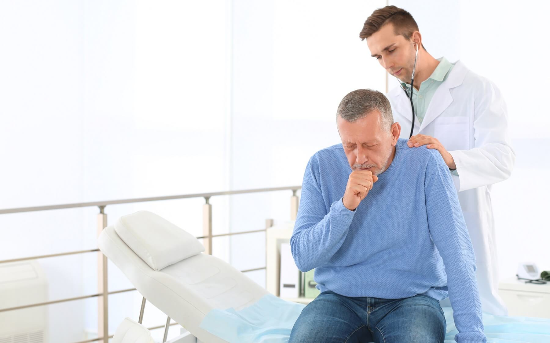 Patient getting a lung exam from a doctor