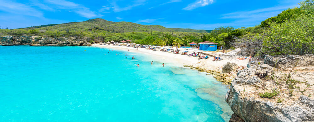 Crystal clear water and fantastic sights bring travelers to Curacao. Let Passport Health help you stay healthy while you're there with travel advice and more.