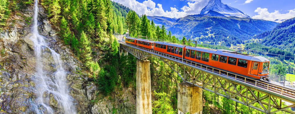 Waterfalls, trains, forests, Switzerland has so much to enjoy. Passport Health will help you stay healthy throughout your stay.